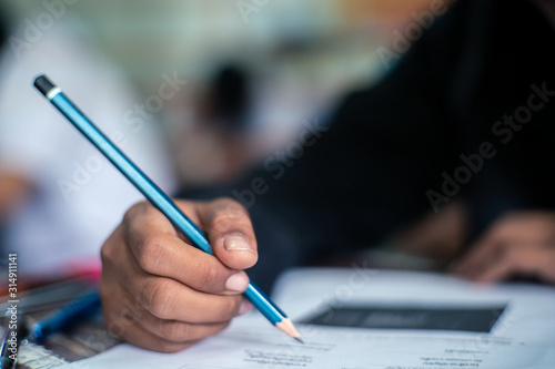 Cuadros en Lienzo  Hand of Student doing test or exam  in classroom of school with stress