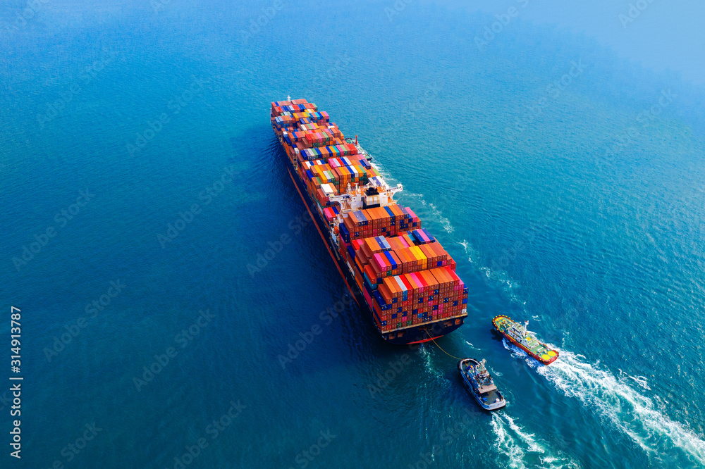 Fototapeta Aerial view of container cargo ship in sea.