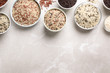 canvas print picture - Different sorts of rice on light grey marble table, flat lay. Space for text