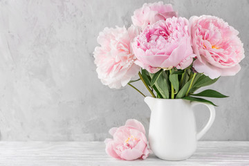 pink peony flowers bouquet on white background with copy space. still life. womens day or wedding concept