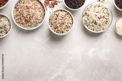 Different sorts of rice on light grey marble table, flat lay Tableau sur Toile