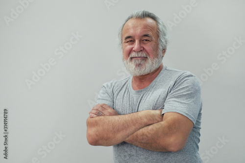 Portrait of healthy happy smile senior elderly old arm crossed with copy space