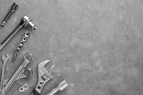 Fotomural Auto mechanic's tools on grey stone table, flat lay