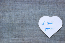"""Valentines Day Background. White Heart With Text """"I Love You"""" On Grey Matting Background, Copy Space, Top View. Greeting Card Template. Concept Of Happy Valentine Day. Mothers Day, 8 March Card."""