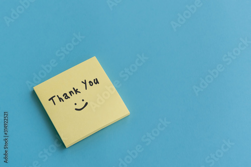 Thank you note on stocky note on blue background Wallpaper Mural
