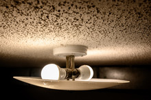 Popcorn Textured Ceiling With LED Bulb Light Fixture And Glass Cover