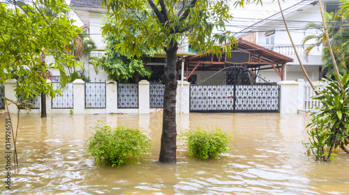 Housing in Jakarta city flooded by rainstorm Canvas Print