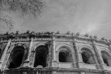 Nimes, France, 13 March, 2018: Roman Coliseum In Nimes South Of France. Black & White The Old Version Againts The New One.