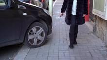 Driver Parking His Black Car O...