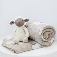 A Gray And White Knitted Toy S...
