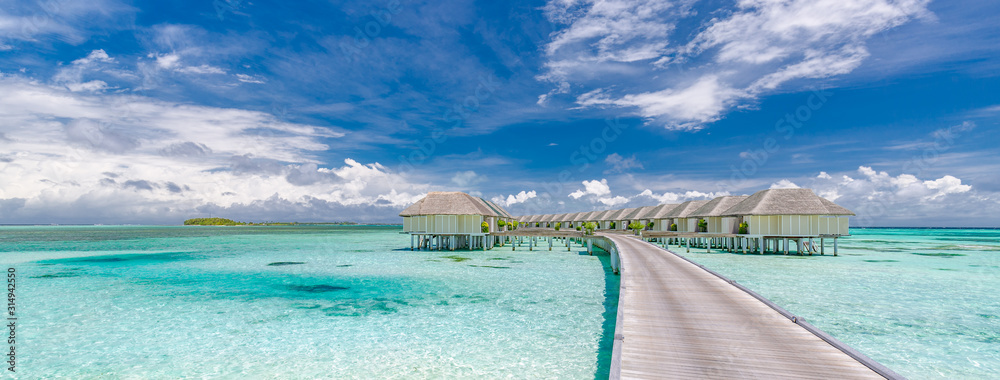 Fototapeta Panoramic landscape of Maldives beach. Tropical panorama, luxury water villa resort with wooden pier or jetty. Luxury travel destination background for summer holiday and vacation concept.