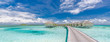 Panoramic landscape of Maldives beach. Tropical panorama, luxury water villa resort with wooden pier or jetty. Luxury travel destination background for summer holiday and vacation concept.