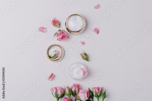 Carta da parati  Homemade spa with rose cosmetic cream on pink background top view