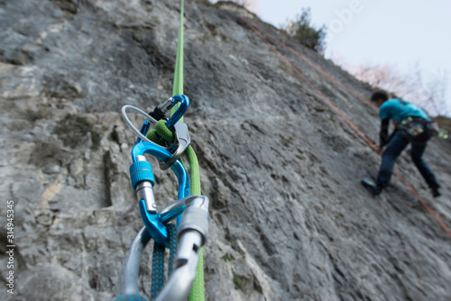 Abseiling with double rope from a mountain wall, close up on the safety equipmen Wallpaper Mural