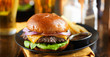canvas print picture cheeseburger and fries on plate served with beer at restaurant