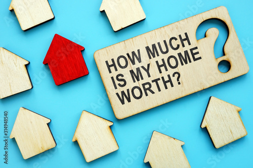 Photo How Much is My Home Worth sign and red house model.