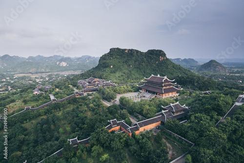 Fotografie, Obraz Ninh Binh, Vietnam - May 2019: aerial view from Bai Dinh stupa over Buddhist tem