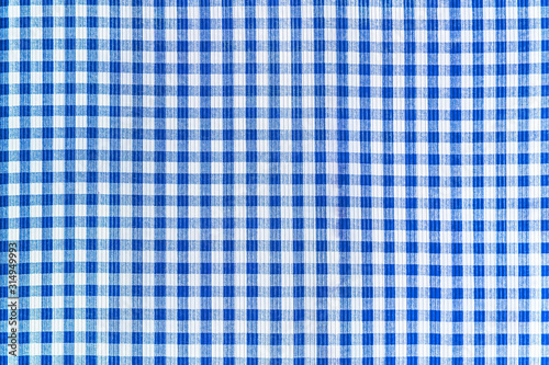 Blue and white abstract checkered fabric texture, pattern background