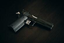 1911 Handgun Pistol On Wood Grain