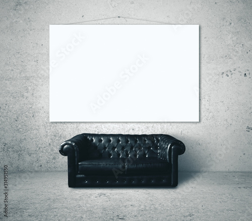 Black leather sofa and blank banner