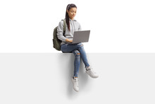 Female Student Sitting On A Bl...