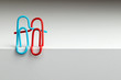 Paper clips in the form of a hugging couple in love for the concept of happy relationship