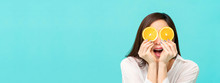 Woman With Sliced Oranges At T...