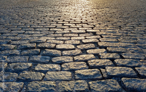Valokuva Light shining on a cobblestone street background texture, New York City