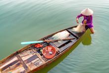Vietnamese Woman In Bamboo Hat...