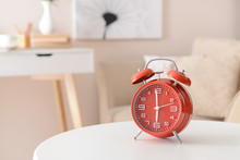 Alarm Clock On Table In Room