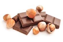 Tasty Chocolate With Hazelnuts On White Background