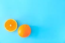 Sweet Oranges On Color Backgro...