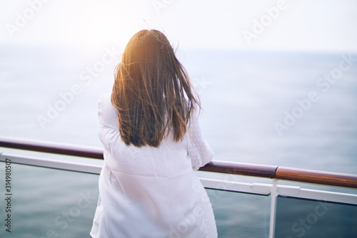 Fotografía Young beautiful woman on vacation standing on a deck of ship with smile on face