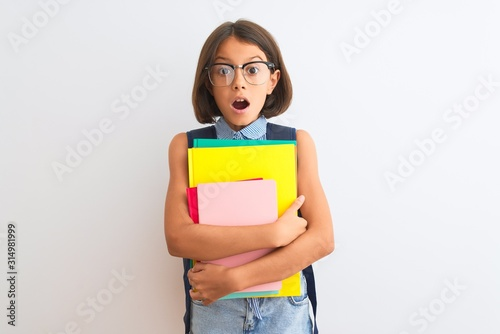 Photo Beautiful student child girl wearing backpack glasses books over isolated white