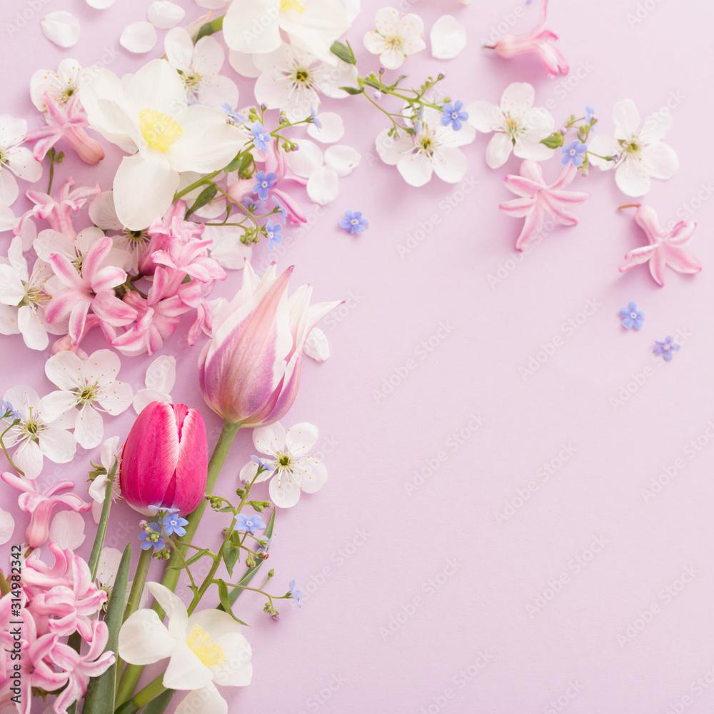 Fototapeta beautiful spring flowers on paper background