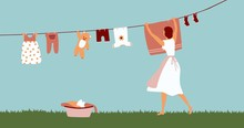 Woman Doing Laundry Outdoor. G...