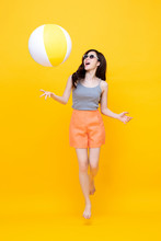 Happy Young Asian Woman In Casual Summer Clothes Playing Beach Ball