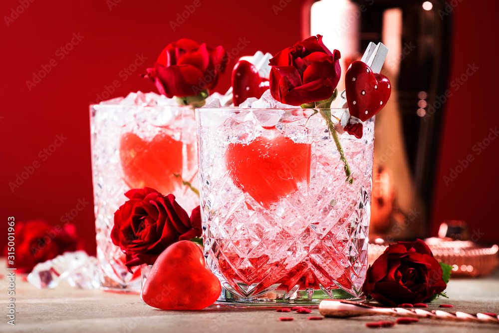 Fototapeta Roses julep Valentine's day cocktail with red roses and hearts on a festive background