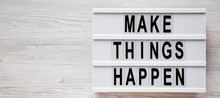 'Make Things Happen' Words On A Modern Board On A White Wooden Background, Overhead View. Top View, From Above, Flat Lay. Copy Space.