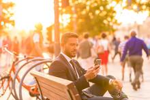 A Businessmen Sitting On A Ben...