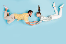 Top View Above High Angle Flat Lay Flatlay Lie Concept Full Length Body Size View Of Nice Cheerful Couple Flying Holding Hands Isolated On Bright Vivid Shine Vibrant Blue Turquoise Color Background