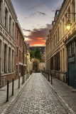 Fototapeta Uliczki - Street in Paris at Dusk with Beautiful Illuminated Lamps