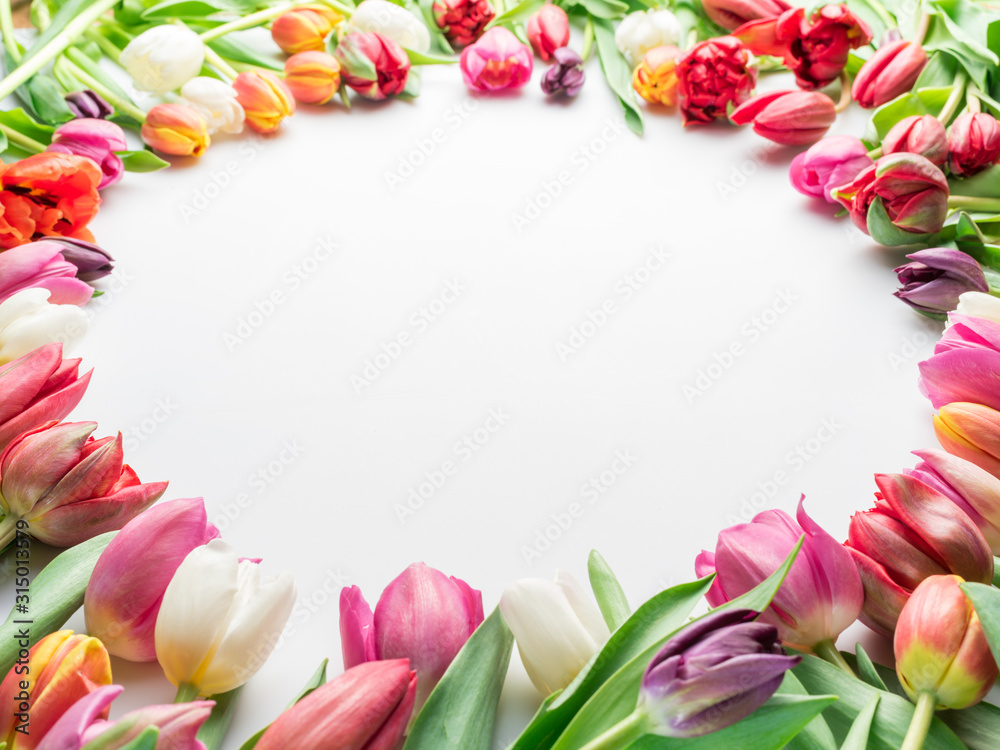 Fototapeta Colorful bouquet of tulips on white background.