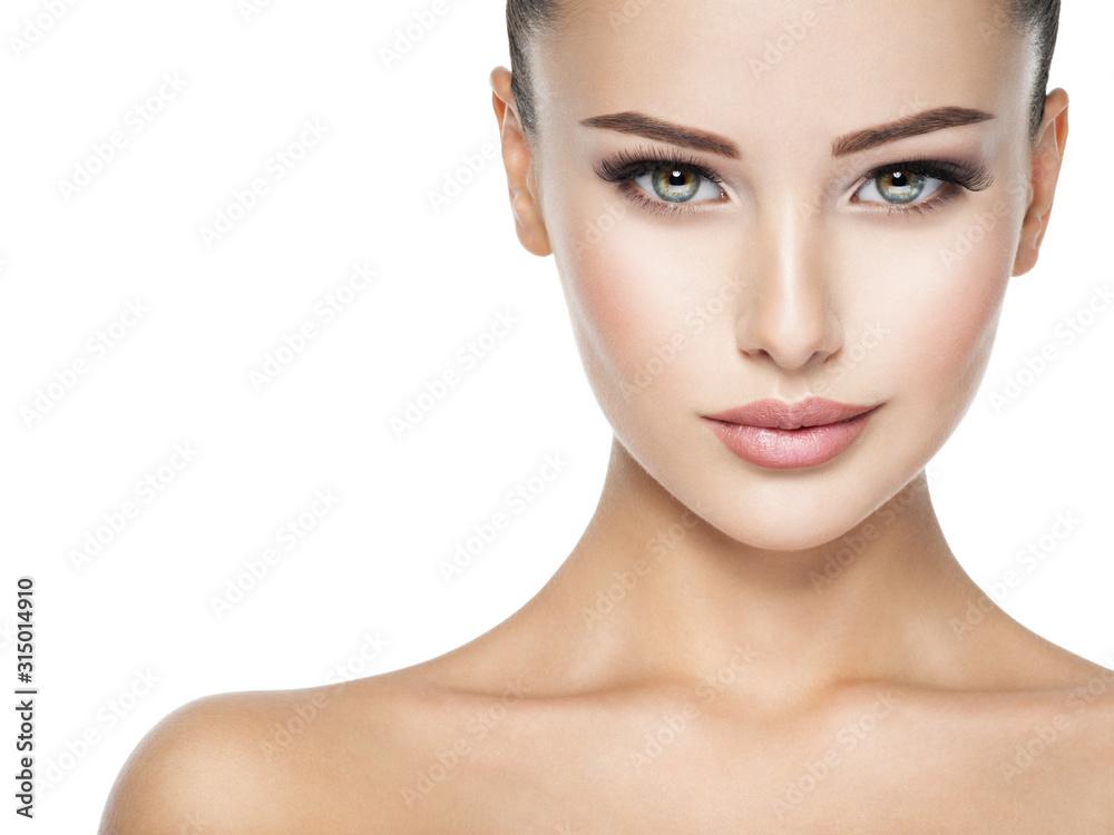 Fototapeta Beautiful face of young woman with  health fresh skin