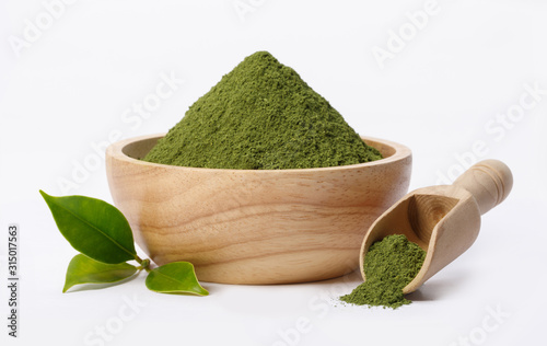 Obraz Matcha green tea powder in bowl with Organic green tea leaf isolated on white background, Organic product from the nature for healthy with traditional style - fototapety do salonu