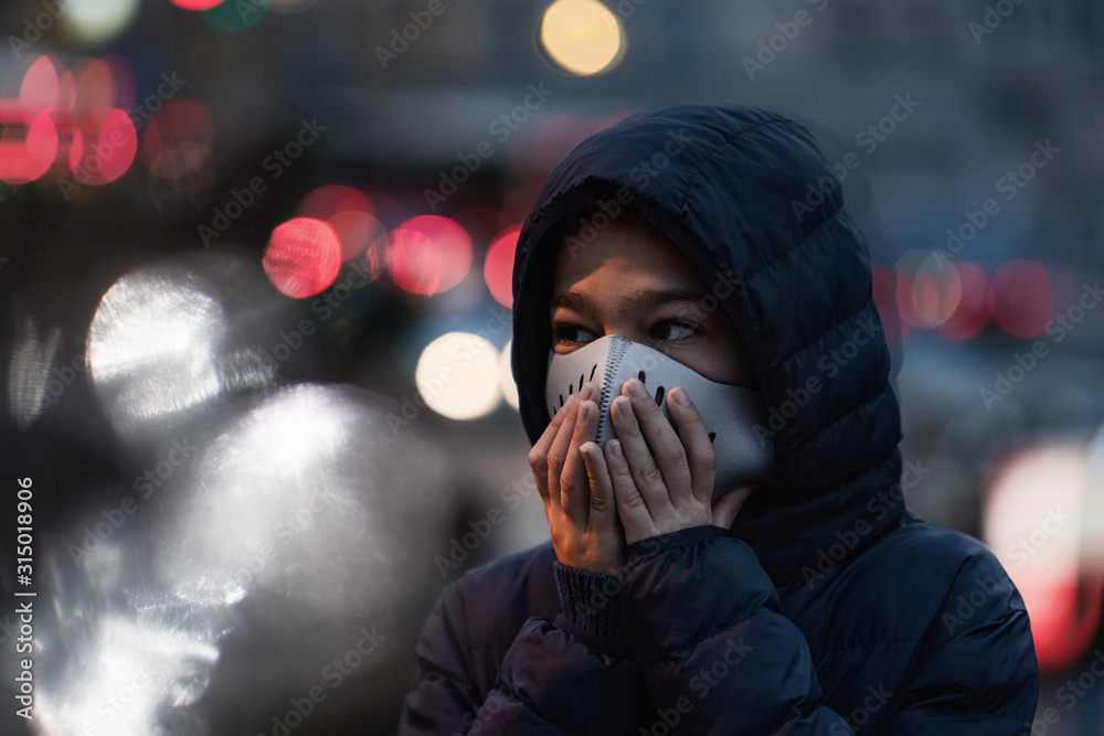 Fototapeta Polluted Air in the City. Wearing protective Mask