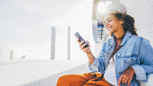 Smiling Woman Using Smartphone...