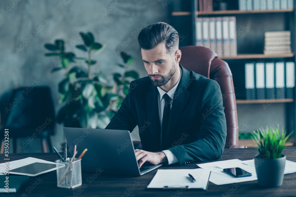 Fototapeta Photo of handsome business guy notebook table chatting with colleagues partners seriously reading corporate report wear black blazer white shirt suit sitting chair office indoors