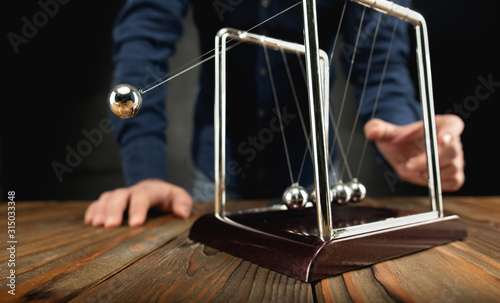 Fotografie, Obraz Concept For Action and Reaction in Business With Newton's Cradle with Businessma