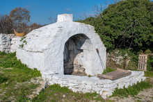 Ancient Old Stone Oven In A Co...